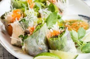 Vietnamese spring rolls on a white platter.