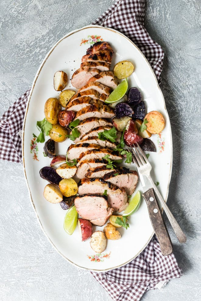 A lightning fast recipe that's perfect for busy weeknights, this easy, breezy grilled pork tenderloin is marinated in honey, lime, and smoky chipotle pepper. The sweet and spicy marinade does most of the work for you; when you get home, it cooks up in less time than it takes to pre-heat the grill. Take that, Wednesday night!