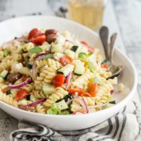 This amazing recipe for Greek pasta salad is the gold standard of easy-to-make potluck salads. It's colorful, crunchy, a little salty, and a whole lot of refreshing. When was the last time you had a pasta salad that was actually refreshing?