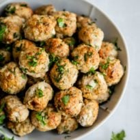 Turkey meatballs in a white serving bowl.