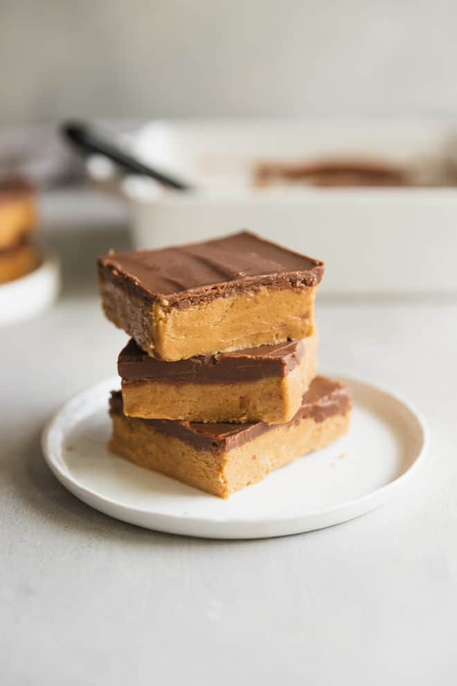 "My Grandma calls these no-bake Peanut Butter Bars ""Almost Reese's"" for good reason—they're as close to the real deal as I've ever tasted. They come together in 10 minutes with only 5 ingredients and they're naturally gluten-free; the only hard part is trying not to eat them all."