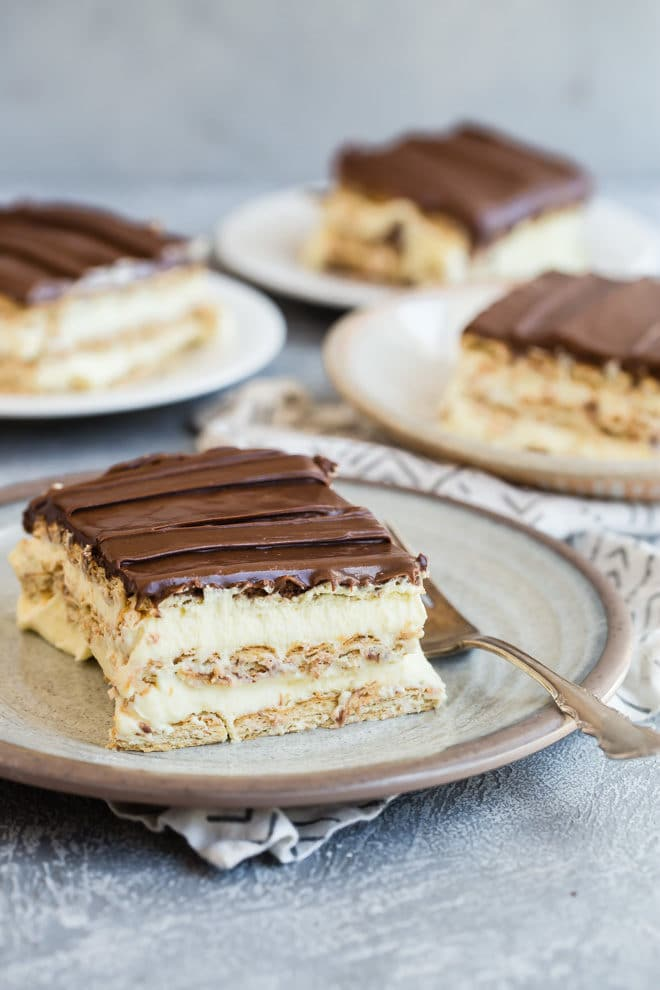 This no-bake easy chocolate eclair cake is the recipe my mom used to make, and one of my family's favorites. Inspired by the chocolate eclair cake Portillo's serves, it comes together in about ten minutes—all you have to do is make it the day before you need it, put it down on the table with some forks, and get out of the way.