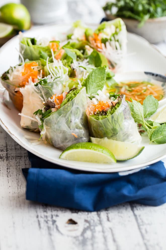 Pack up your picnic baskets and find a blanket--this recipe for Vietnamese spring rolls with nuoc cham for dipping was made for outdoor eating. Easy and fun to make ahead of time, these spring rolls are a huge hit for anyone who likes fresh flavors and lots of delicious textures.