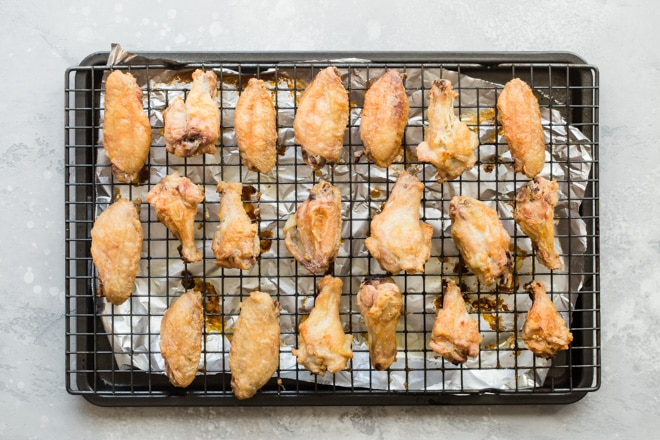 If you're ready to up your game in the chicken wing department, and score big points with your home team, these oven-baked Chinese Chicken Wings are exactly what you should make for your next party. These are the best crispy baked chicken wings and they're tossed in a easy-to-make dry rub that's bursting with spicy, smoky flavor. Skip the sauce, save your furniture, and take your tastebuds on the adventure of a lifetime.