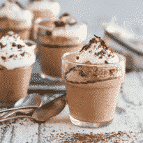 Easy chocolate mousse in little clear glasses.