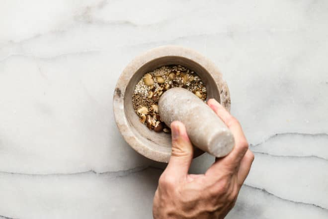 Learn how to make Dukkah (pronounced DOO-kah), and discover a new way to add texture and flavor to your dishes. This Egyptian nut-and-seed blend can be salty, sweet, or spicy depending on how you make it. Try my base blend or mix in countless other ingredients from my list of suggestions. Use Dukkah as a topping, garnish, or even a healthy snack mix!
