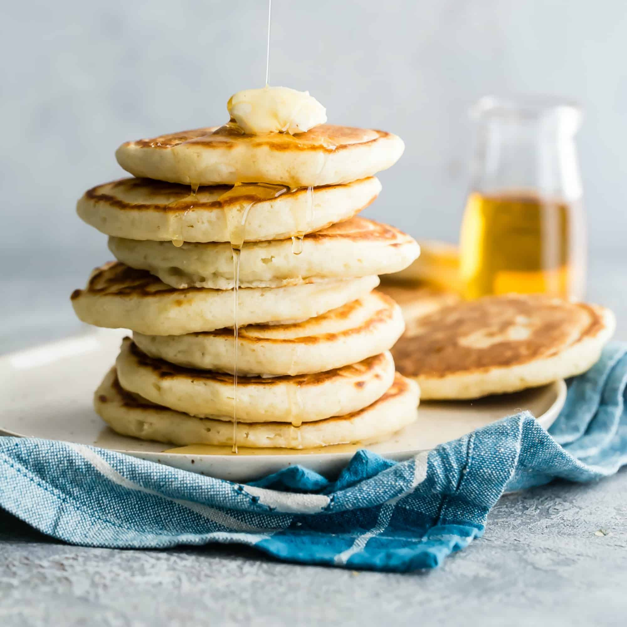 Once you learn how to make pancakes from scratch, you'll never buy a box mix again! Using ingredients you already have in your kitchen, whip up the fluffiest, tastiest pancakes around, with or without syrup. I have all your variation questions covered, too! Even the one where you want to make pancakes on your next camping trip.