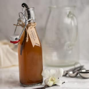 A picture of a bottle of homemade vanilla extract.