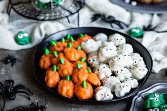 Halloween walnuts on a black plate.