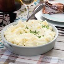 These Make Ahead Mashed Potatoes are your Thanksgiving Day dream come true. Mash them up the day before, and heat them in the oven or slow cooker. If it's your job to bring the potatoes, your job just got easier.