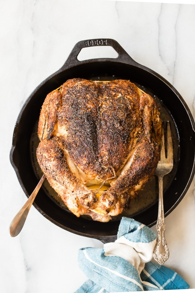 Rotisserie chicken in a cast iron skillet.