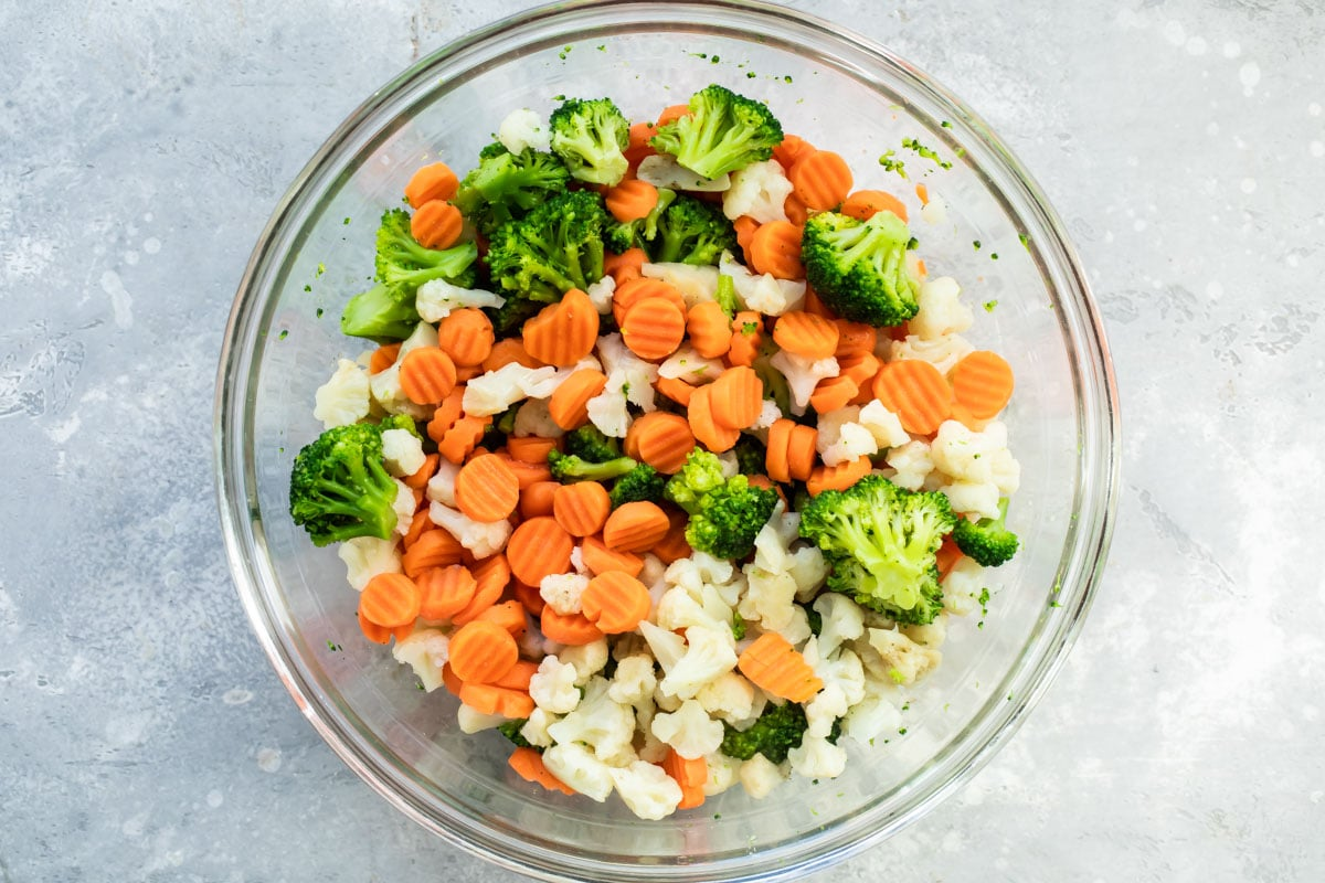 Frozen vegetables in a glass bowl.