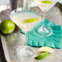 Hemingway daiquiri in a martini glass with a slice of lime.