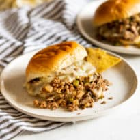 Philly Cheesesteak Sloppy Joes combines two family favorites into one crazy delicious sandwich you'll be asked (begged) to make on a regular basis. It's lightning-fast to make in a skillet or crockpot, and is a sure thing with kids and adults alike.