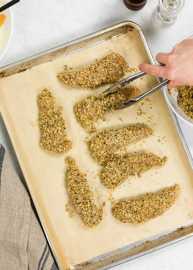 Walnut crusted chicken on a baking sheet.