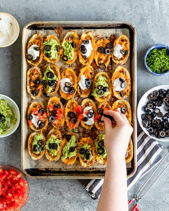Hearty, delicious appetizers are essential to any party and especially your Game Day spread. These Baked Potato Skins can be made ahead and customized with your favorite toppings, or double/triple the recipe and feed the whole block. You won't have leftovers!
