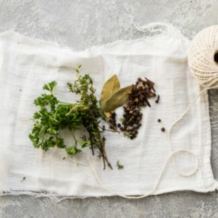 A sachet bag filled with herbs, spices, and other aromatics is an easy-as-it-gets way to add flavor to simmering soups, poaching liquids, or mulled wine. Grab the kitchen twine and some cheesecloth and let's sachet!