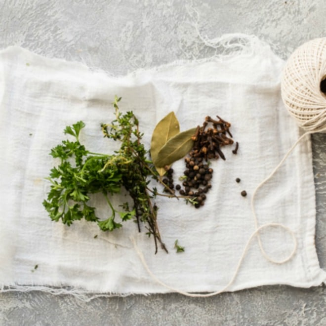 A sachet bag with herbs, spices, and other aromatics.