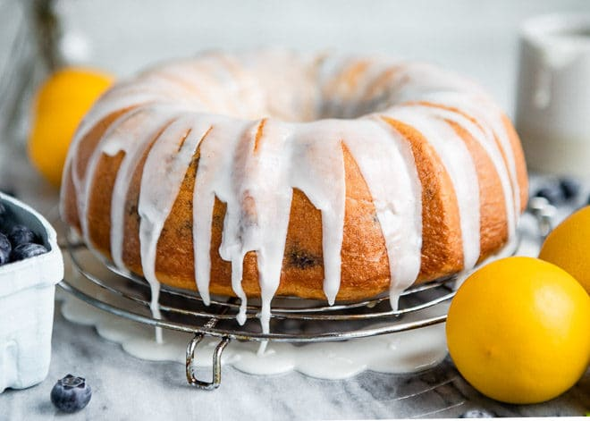 My ultimate Lemon Bundt Cake recipe - now updated with blueberries! Dress up a boxed lemon cake mix for the ultimate easy spring dessert. Trust me, you're going to love it.