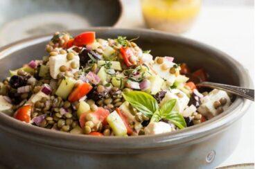 Mediterranean lentil salad in a grey bowl.