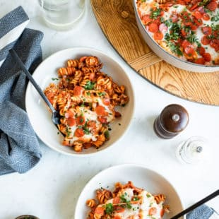 Pizza pasta bake in two white bowls.