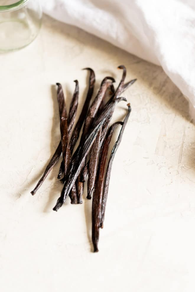 Skip the synthetic versions and avoid the high prices at the market: Learn how to make vanilla extract from scratch. Use it for baked goods, drinks, and all your favorite vanilla bean recipes. This homemade vanilla extract recipe takes just two ingredients and a pretty bottle!