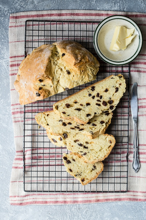 A thick slice of Traditional Irish Soda Bread, a generous smear of butter, and a cup of strong tea makes almost everything better. Buttermilk and baking soda are the magic ingredients in this fabulous yeast-free bread that needs no time to rise, and gets gobbled up fast.