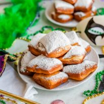 It's Mardi Gras and I'm dreaming of the wonderful, sweet scent of beignets! But why travel to New Orleans and Cafe du Monde to grab these sugary delights when you can recreate the magic in your home kitchen? Make your best cafe au lait and get ready to be covered with powdered sugar.  Don't worry, it's totally worth it!