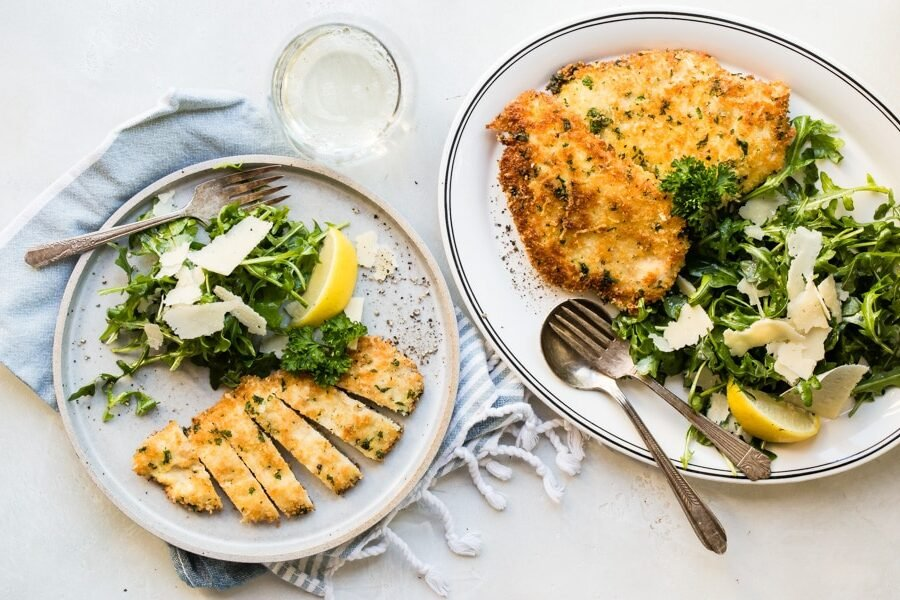 Who can resist Chicken Milanese, a crispy chicken cutlet topped with a bright and lemony arugula salad and ribbons of Parmesan cheese? Young, old, and everyone in between gobble up this recipe, and for good reason: it's universally adored.
