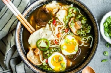 Chicken ramen in a bowl with chopsticks.
