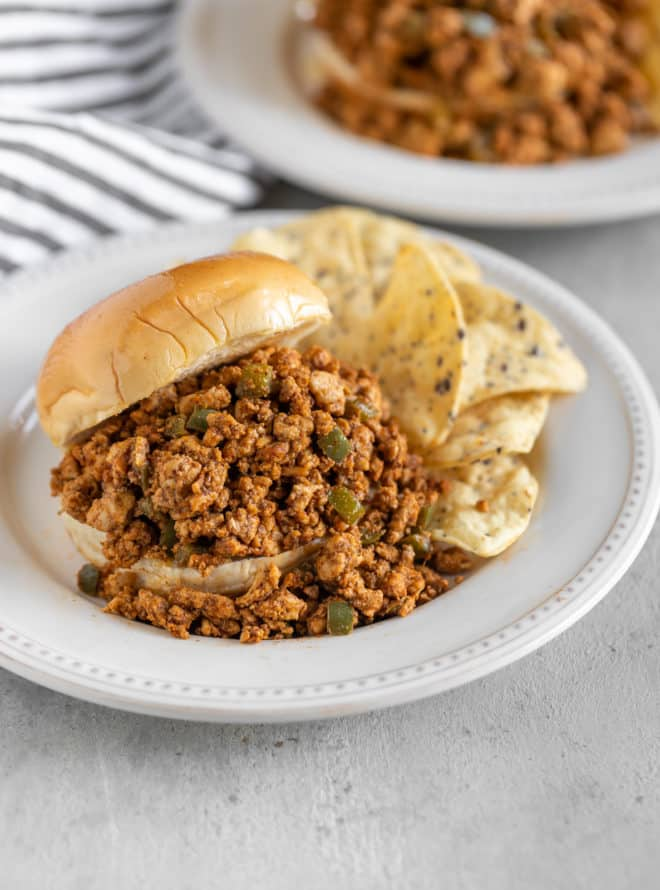 Chipotle chicken sloppy joes on a white plate.