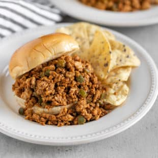 A delicious and spicy update on a classic, Chipotle Chicken Sloppy Joes are my new favorite way to have dinner on the table, from stove to plate, in half an hour. And it all starts with one little pantry ingredient.