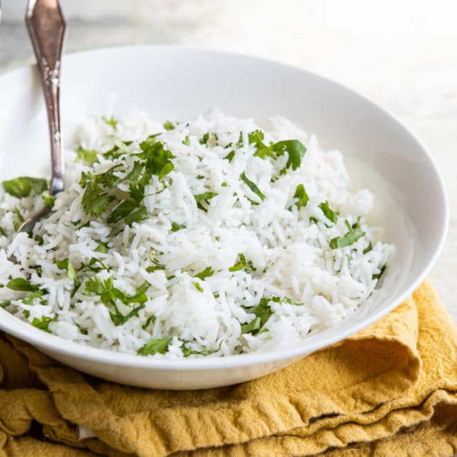 Chipotle cilantro lime rice in a white bowl.
