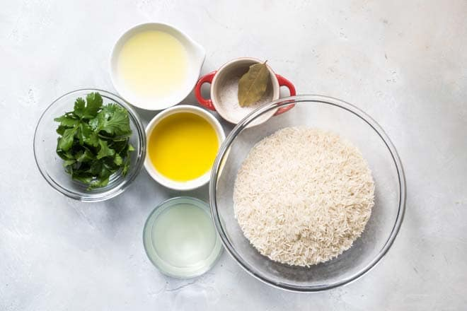 Learn the secrets to making Chipotle Cilantro Lime Rice in the comfort of your own kitchen. This copycat recipe starts with getting the right type of rice and cooking it in a non-traditional way. This rice is soft and fluffy with just the right amount of chew and no stickiness.
