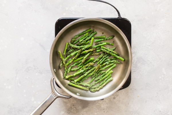 An easy recipe for Cream of Asparagus Soup with a secret ingredient for the brightest color and flavor. It's the perfect way to celebrate when the season's first green stalks appear.