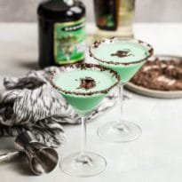 Two grasshopper cocktails in martini glasses.