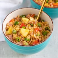 A classic combination of sweet pineapple and salty ham come together in this homemade version of Hawaiian Fried Rice. Adding the trifecta of garlic, ginger, and scallions transforms this into an authentic Chinese dinner.