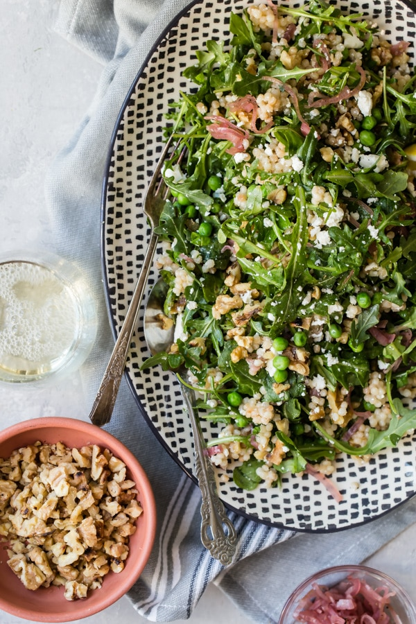 This recipe for Israeli Couscous Salad welcomes any changes you feel like making to it, but I make mine with toasted walnuts, feta, mint, peppery arugula, and quick pickled shallots; every forkful is fresh and fantastic. It's really tempting to eat the whole bowl in one sitting.