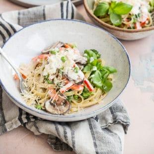 Pasta primavera in a white bowl.