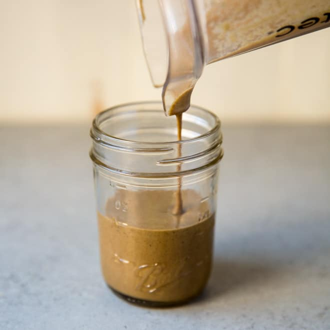 Homemade tahini is an amazing pantry staple that adds richness and dimension to hummus, cookies, and salad dressings. If you have a high powered blender or food processor, tahini is also wonderfully simple to make. This recipe is  vegan, gluten-free, and completely delicious.