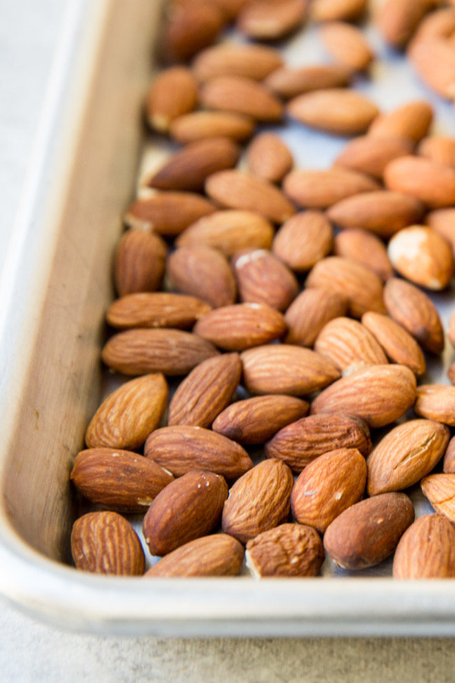 Almonds on a baking sheet.