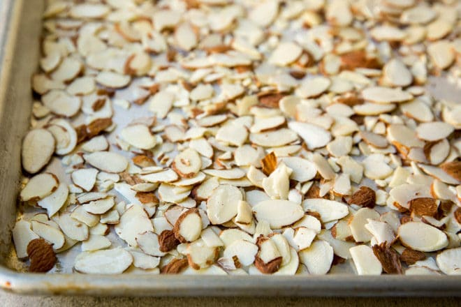 Almond pieces on a baking sheet.