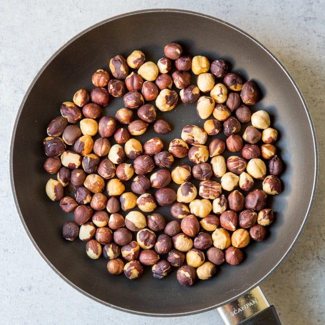 An easy recipe for how to toast hazelnuts (filberts) in the oven or on the stove. Enhance the flavor of hazelnuts, then add to salads, snack mixes, baked goods, and more! Also, learn the secret to removing hazelnut skins.