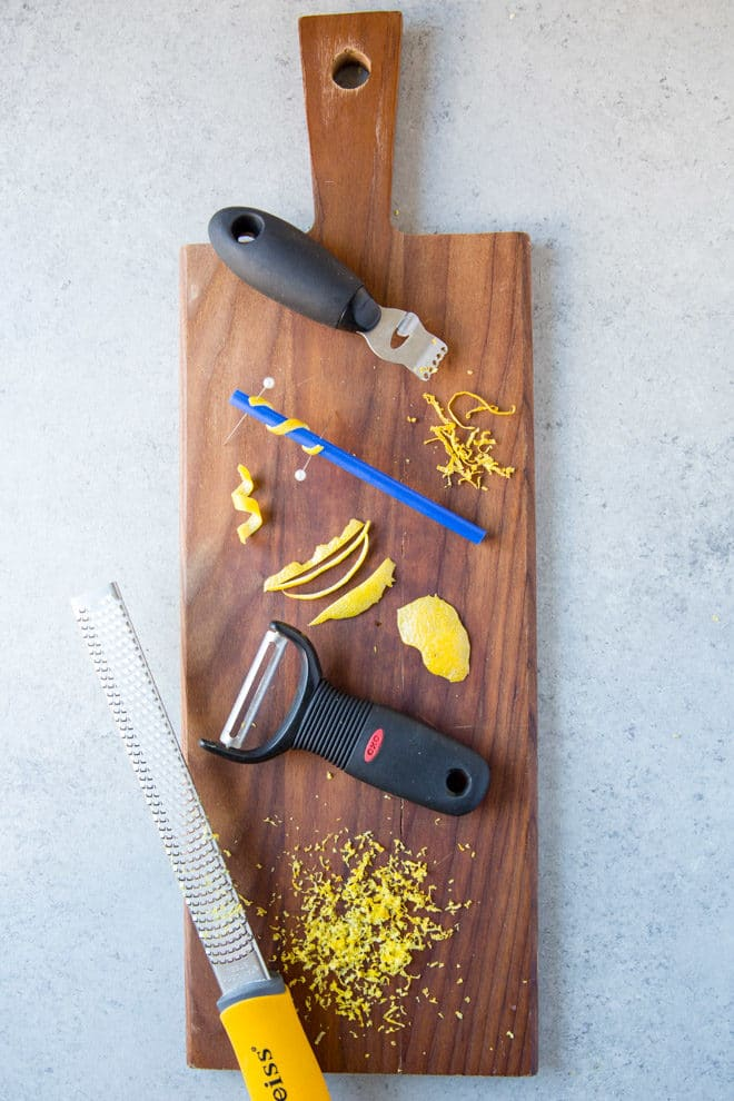 Lemon zest adds sunshine to all your favorite spring and summer soups, salads, and lemon desserts! You don't need a fancy gadget, either; here's how to zest a lemon with (almost) anything you have in the kitchen, as well as make a picture perfect twist for any cocktail.