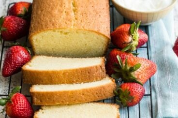Easy pound cake slices on a cooling rack.