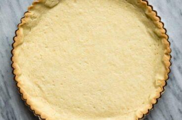 A baked tart crust in a tart pan.