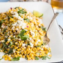 Mexican corn salad on a white platter.