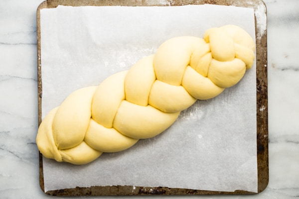 Challah is a traditional Jewish bread made every week for the Sabbath and for most Jewish holidays. I have an easy Challah recipe that is simple to master. It's rich and decadent with a beautiful golden color and pillow-soft texture. And that three-strand plait will impress everyone at the table!