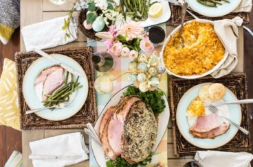 A decorated table with a traditional Easter feast.