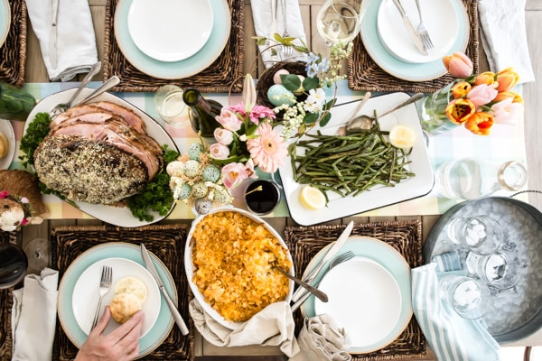 An overhead shot of a decorated table with a traditional Easter feast.
